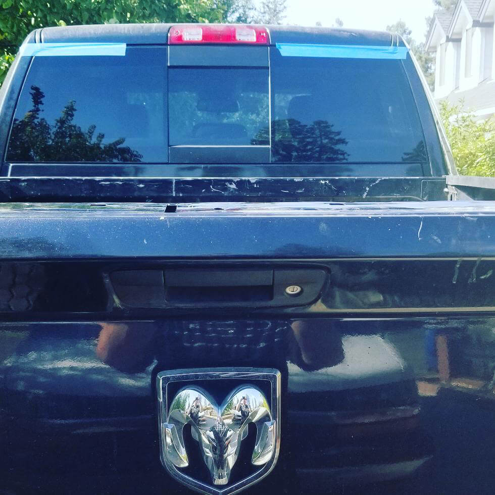 Back of Dodge RAM truck with new rear sliding glass