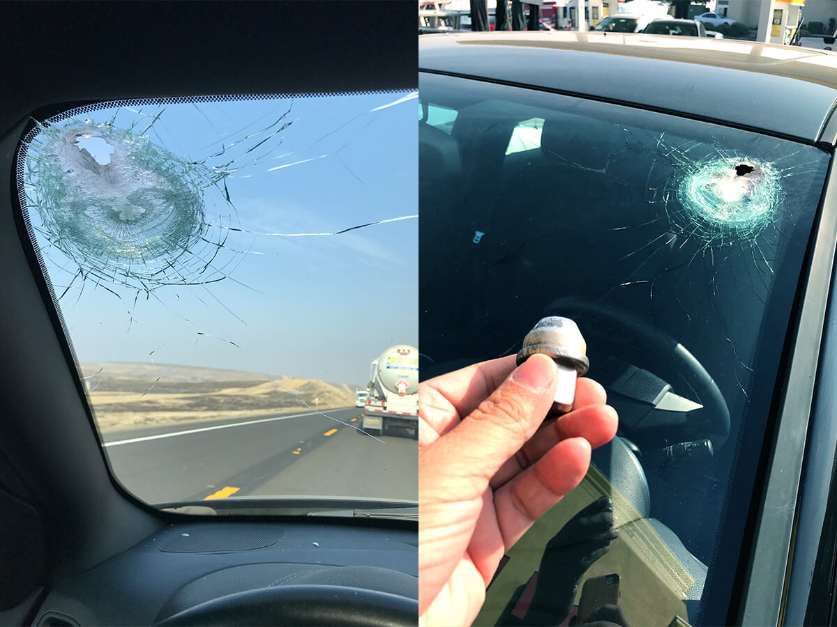 Hole in windshield caused by lug nut shown from inside and outside the car